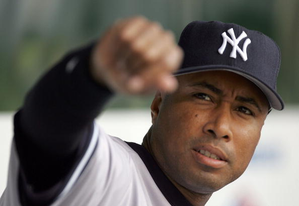 BALTIMORE - JUNE 03: Bernie Williams #51 of the New York Yankees greets fans from the dugout prior to the game against the Baltimore Orioles on June 3, 2006 at Oriole Park at Camden Yards in Baltimore, Maryland. The Yankees defeated the Orioles 6-5 in 10 innings. (Photo by Jamie Squire/Getty Images)